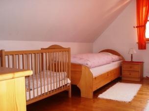 Podkrovní pokoj číslo 1